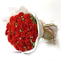 40 Red Carnations wrapped with woven paper