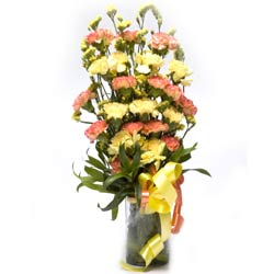 20 Yellow and Orange Carnations in a glass vase