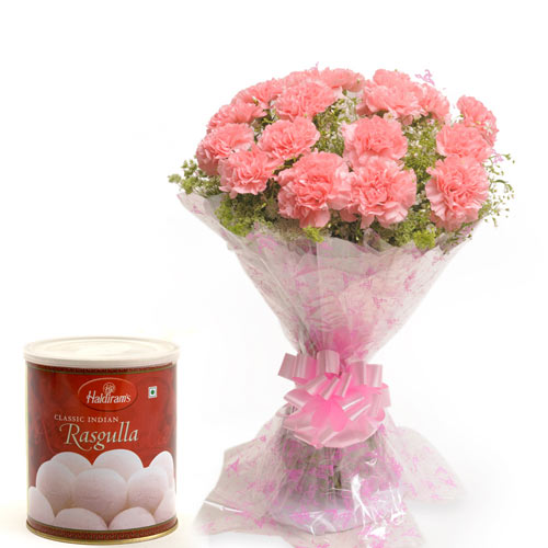 15 Pink Carnations wrapped in a colour paper with 1kg Rasgulla