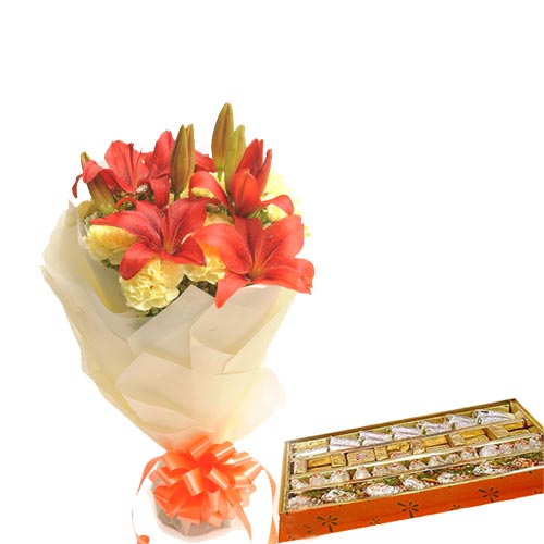 10 Yellow Carnations and 2 Orange Lillies wrapped in a colour paper with 1kg Mixed sweets