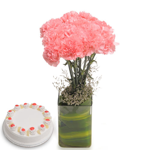 10 Pink Carnations in a desinger glass vase with 500gms Pineapple cake