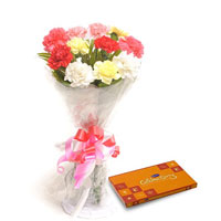 12 Mix Carnations packed in a colour paper with Cadbury celebration chocolate