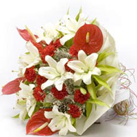 15 Red Carnations 6 White Lillies and 5 Red Anthuriums wrapped in a colour paper