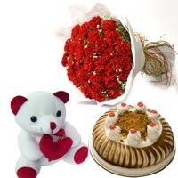 50 Red Carnations wrapped in a colour paper ribbon with 500gms Butter scotch cake and 6inch Teddy bear