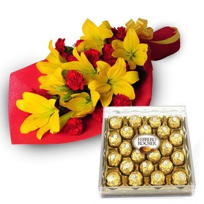 16 Red Carnation and 5 Yellow Lillies wrapped in a colour paper with  24 pcs Ferro rocher