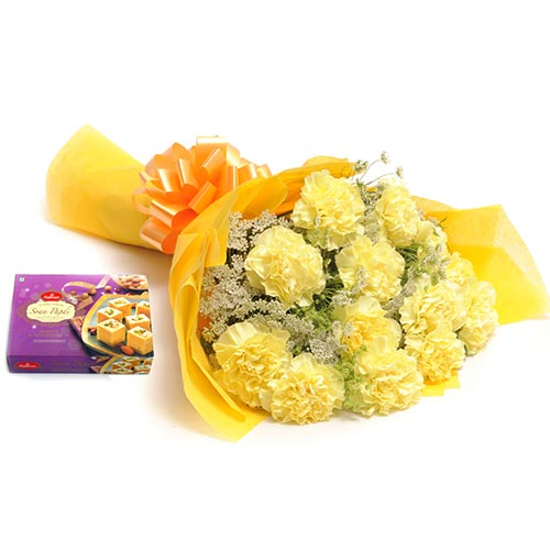 12 Yellow Carnation wrapped in a colour paper with 500gms Soan papdi