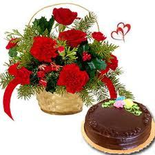 12 Red Carnations arranged in a small basket with 1kg Chocolate cake