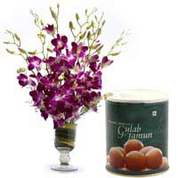 6 Purple Orchids in a desinger glass vase with 1kg Gulab jamoon