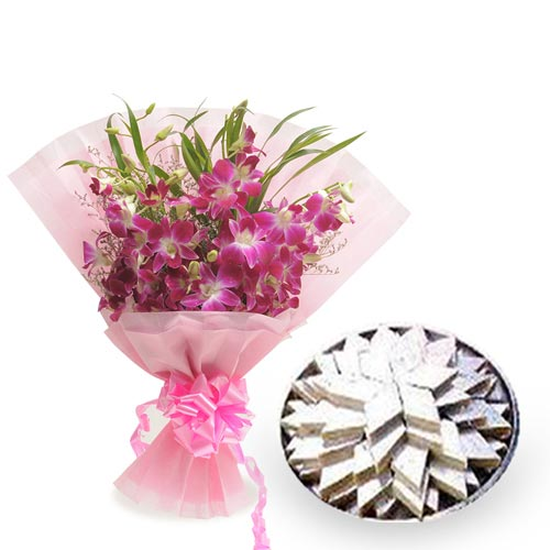 6 Purple Orchids packed in a colour paper with 500gms kaju katli