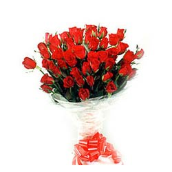 40 Red Roses packed in a cellophane paper with ribbon