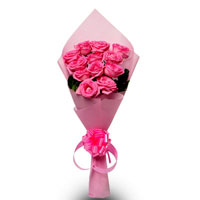 12 Pink Roses packed in a pink paper with ribbon