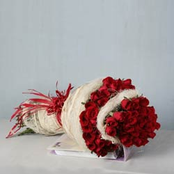 75 Red Roses in a jute packing