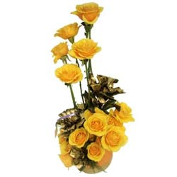 15 Yellow Roses arranged in a cane basket