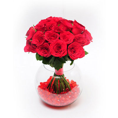 20 Red Roses arranged in a desinger glass vase