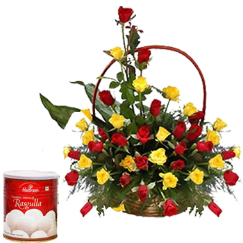 Red and Yellow Roses arranged in a cane basket with 1kg Rasgulla
