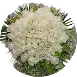99 White Roses arranged in a heart shape