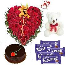 40 Red Roses in a heart shape arrangement with Teddy bear,500gms chocolate cake,18gms Cadbury chocolate