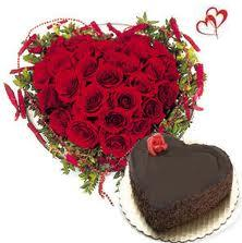 50 Red Roses and Chocolate cake 1kg desinged in a heart shape