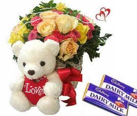 9 Yellow and 9 Pink Roses arranged in a large basket with Teddy bear,18gms Cadbury chocolate