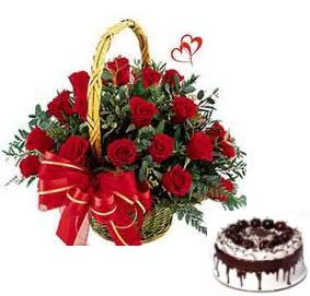 Red Roses arranged in a cane basket with 500gms Black forest