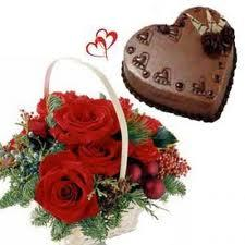 12 Red Roses assembled in a cane basket with 1kg Heart shape Chocolate cake