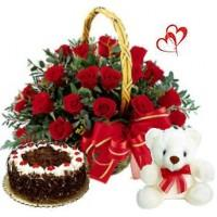 18 Red Roses arranged in a cane basket with 500gms Black forest cake,Teddy bear
