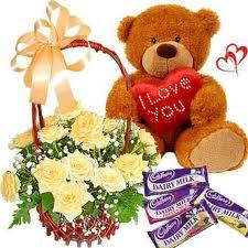 15 Yellow roses arranged in a cane basket with 10inch Teddy bear,18gms Cadbury chocolate