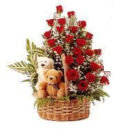 24 Red Roses arranged in a cane basket with 6inch 2 Teddy bears