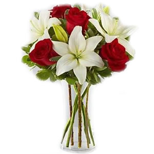 5 Red Roses,5 White Lillies arranged in a glass vase