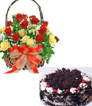 14 Mix Roses arranged in a cane basket with 1kg Black forest