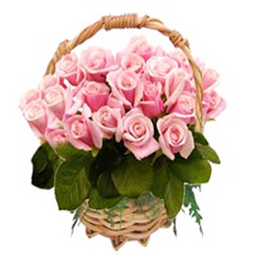 20 Pink Roses arranged in a cane basket