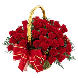 15 Red Roses arranged in a cane basket