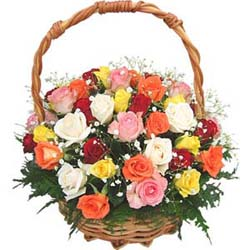 15 Mix Colour Roses nicely arranged in a cane basket