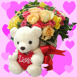 12 Mix Roses arranged in a large basket with 6inch Teddy bear