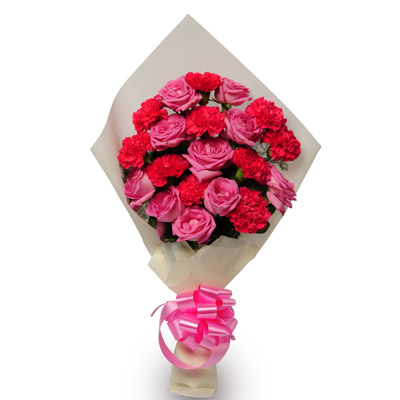 10 Pink Roses and Carnation wrapped with a colour paper