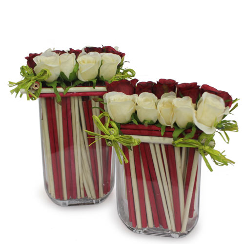 Red and White Roses arranged in a desinger glass vase