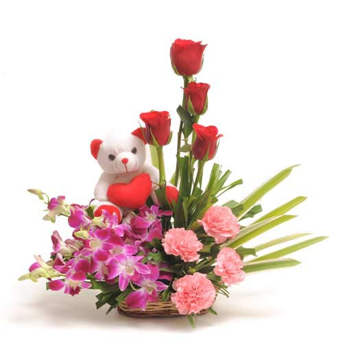 12 Nicely Mix flowers arranged in a small basket with 6inch Teddy bear