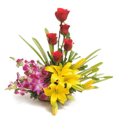 5 Red Roses 4 Purple Orchids 4 Yellow Lillies arranged in a small basket