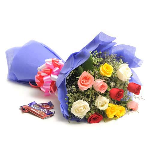 12 Mix Longstem Colour Roses wrapped in a colour paper with Cadbury fruit and nut