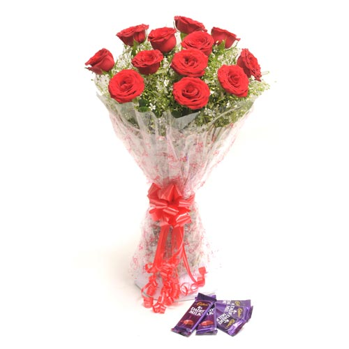12 Red Roses wrapped in a cellophane paper with 18gms 5 Cadbury chocolate