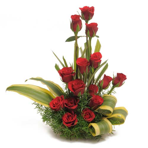 15 Red Roses arranged in a small basket