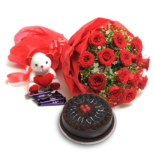 15 Red Roses wrapped in a colour paper with 500gms Chocolate truffle cake and  6inch Teddy bear,18gms 5 Cadbury chocolate
