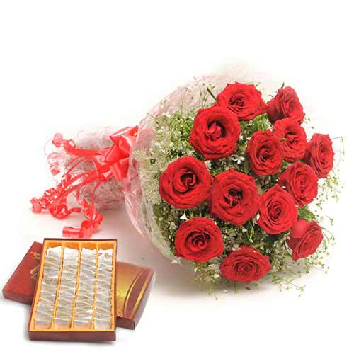 12 Red Roses wrapped in a cellophane paper with 500gms  Kaju katli