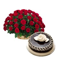 50 Red Roses arranged in a cane basket with  1kg Chocolate cake