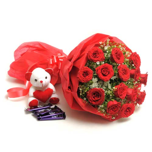 15 Red Roses wrapped in a colour paper with 6inch Teddy bear,18gms Cadbury chocolate