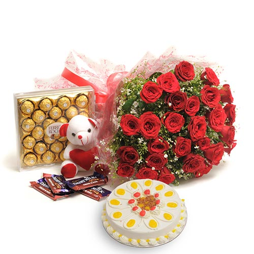 40 Red Roses wrapped in a cellophane paper with 500gms Butter scotch cake and 24 pcs Ferro rocher,Teddy bear 6inch,cadbury chocolate fruit and nuts 46gms