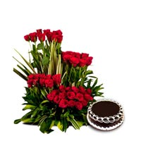 50 Red Roses arranged in a large basket with 1kg Chocolate cake