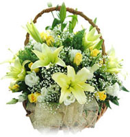 20 White and Yellow Roses,5 white lillies arranged in a cane basket